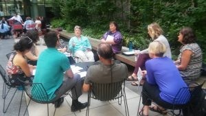 Photo: A small group discussion held outside